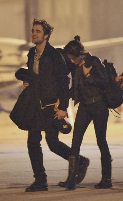 Rob and Kristen Holding hands in London