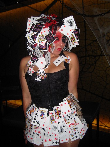 She has a card Hat on her head...at least it matches the skirt.