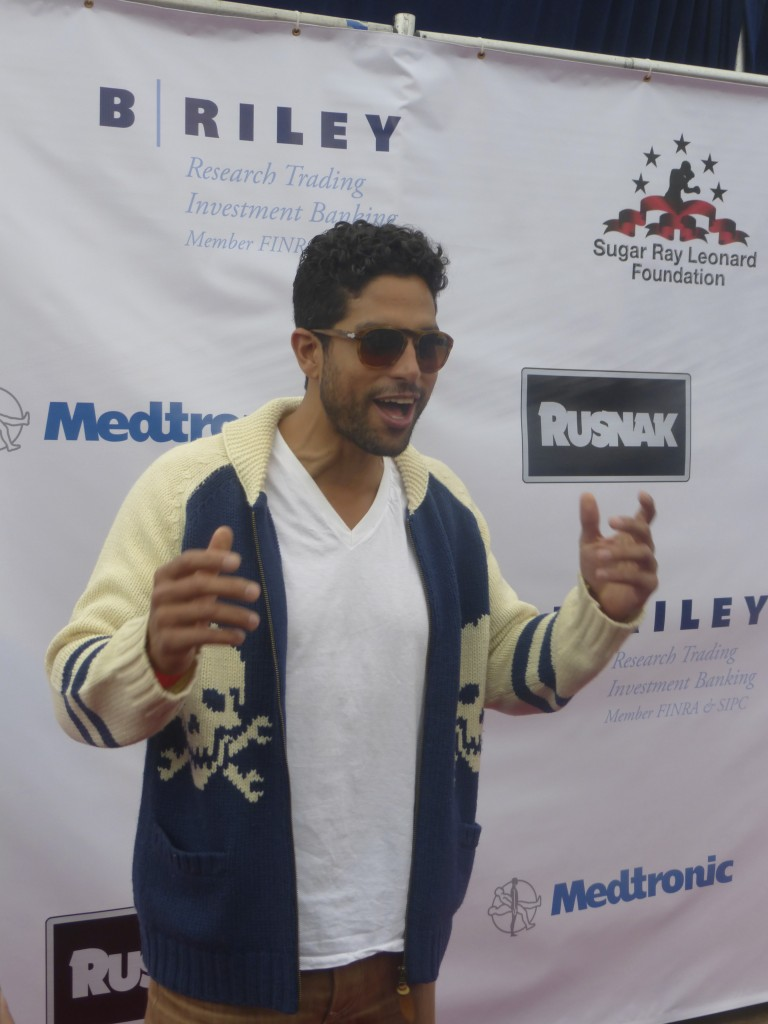 Actor Adam Rodriguez poses on the red carpet wearing his shades for the Big Fighter Big Cause Sugar Ray Leonard Charity Fight night on May 22, 2013