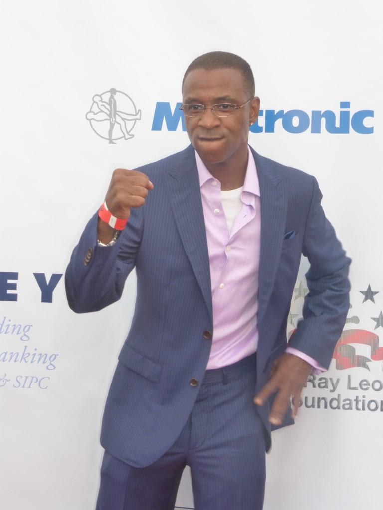 Tommy Davidson strikes a boxing pose at the Sugar Ray Leonard Charity Fight Night at the Santa Monica Pier
