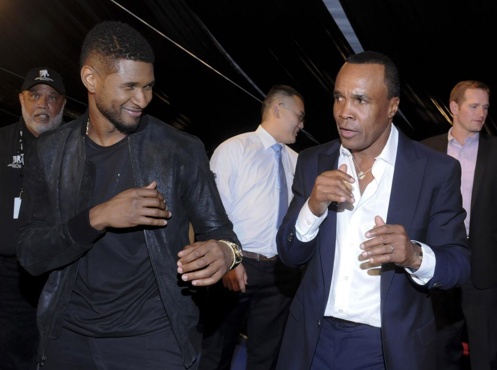 Usher and Sugar Ray Leonard Share boxing moves at the 4th Annual Big Fighters Big Cause Charity Event on May 21, 2013
